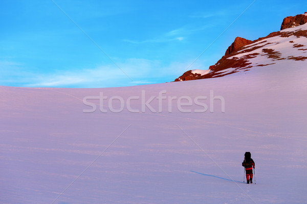 Hiker in sunrise snow mountains Stock photo © BSANI