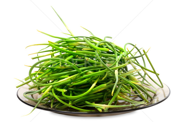 Stock photo: Fresh garlic scapes on plate