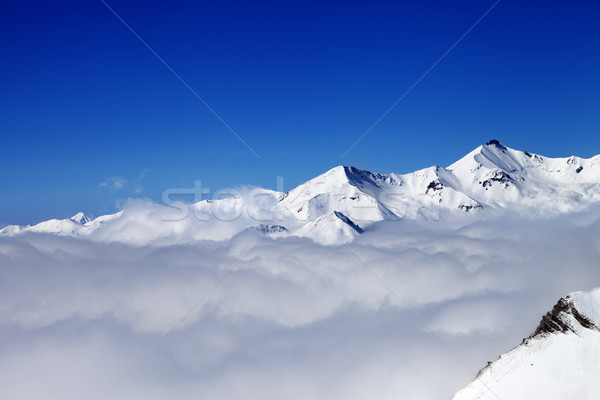 Mountains in clouds at nice day Stock photo © BSANI