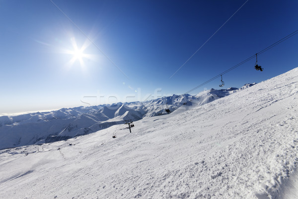 Off-piste slope and blue sky with sun Stock photo © BSANI