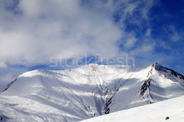 View on off-piste snowy slope in wind day Stock photo © BSANI