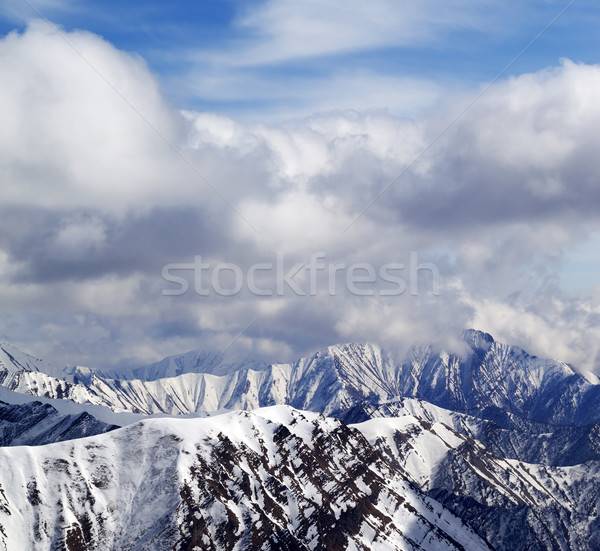 Winter snowy mountains and cloudy sky Stock photo © BSANI