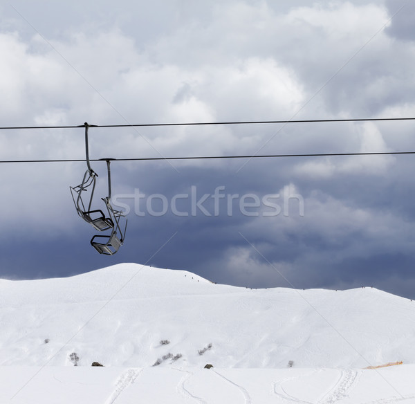 Chair lifts and off-piste slope at windy gray day Stock photo © BSANI