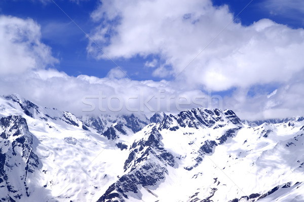 Snowy mountains in sun day Stock photo © BSANI