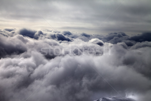 Top of off-piste slope in storm clouds Stock photo © BSANI