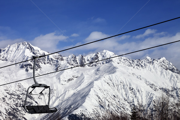 Chair-lift in snow winter mountains at nice sunny day Stock photo © BSANI
