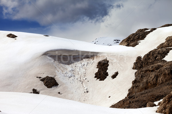 Snow cornice in spring mountains Stock photo © BSANI
