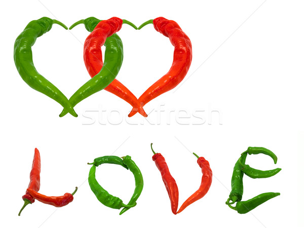 Two hearts and word Love composed of green and red chili peppers Stock photo © BSANI