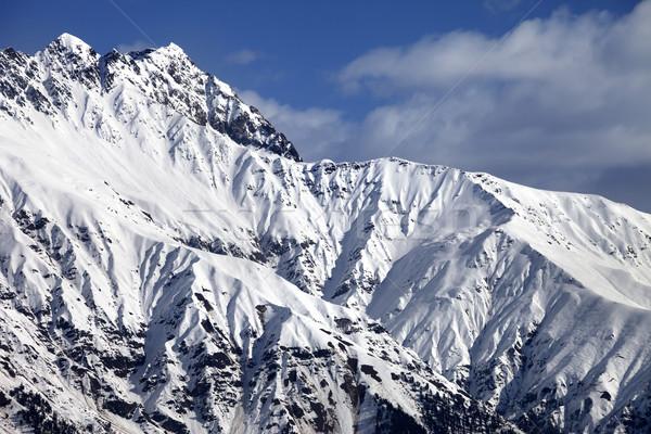 Snowy sunlight mountains at nice day Stock photo © BSANI