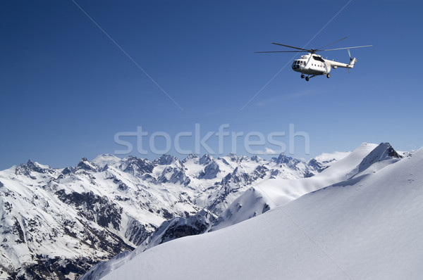 Helicopter in snowy mountains Stock photo © BSANI