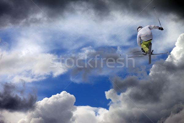 Freestyle ski jumper with crossed skis against cloudy sky Stock photo © BSANI