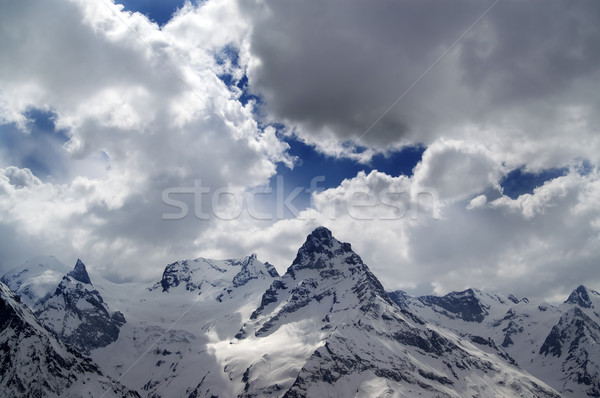 Evening mountains in sunlight clouds Stock photo © BSANI
