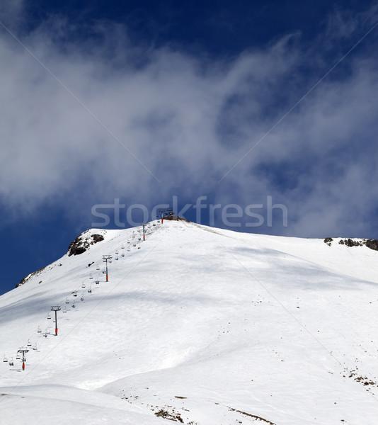 Ski slope and ropeway at sunny winter day Stock photo © BSANI