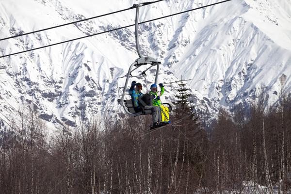 Skiers family on chair-lift at nice sunny day Stock photo © BSANI