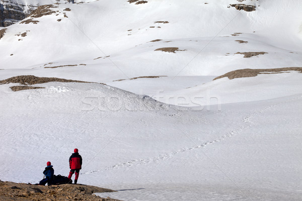Two hikers on halt in snowy mountain Stock photo © BSANI