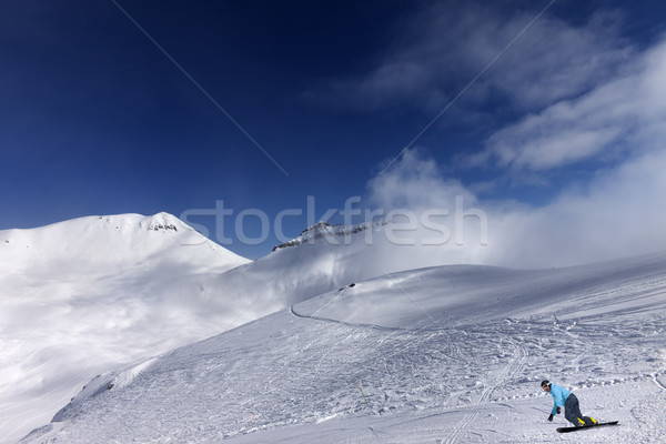 Snowboarder on ski slope at nice day Stock photo © BSANI