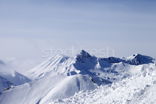 View from off-piste slope at mountains in fog Stock photo © BSANI