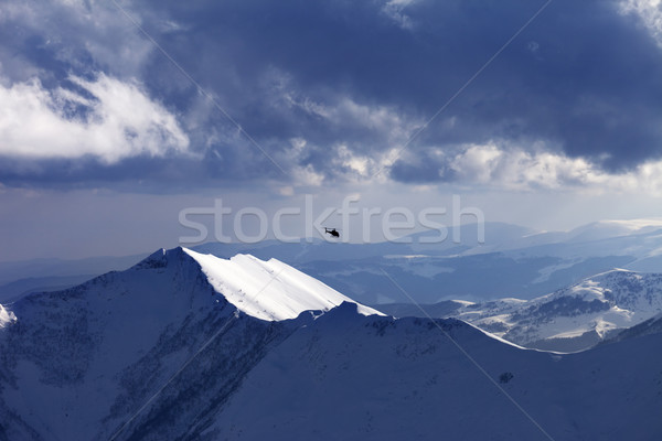 Off-piste slope for heliskiing and helicopter in evening Stock photo © BSANI