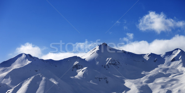 Panoramic view on snowy sunlight mountains Stock photo © BSANI