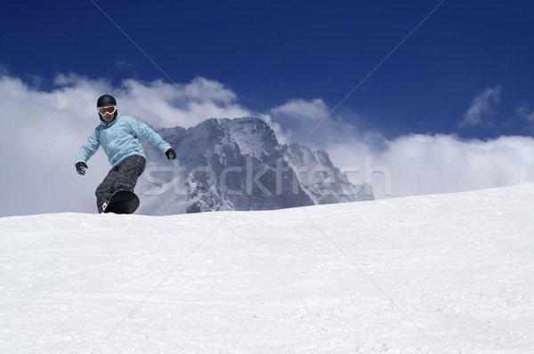 Snowboarding in high mountains Stock photo © BSANI