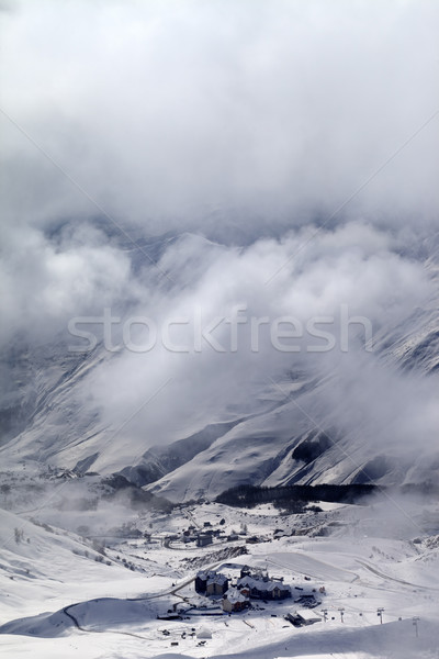 Top view on ski slope and hotels in mist Stock photo © BSANI