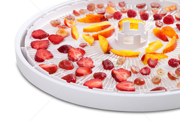 Slices of berries and fruits on dehydrator tray Stock photo © BSANI