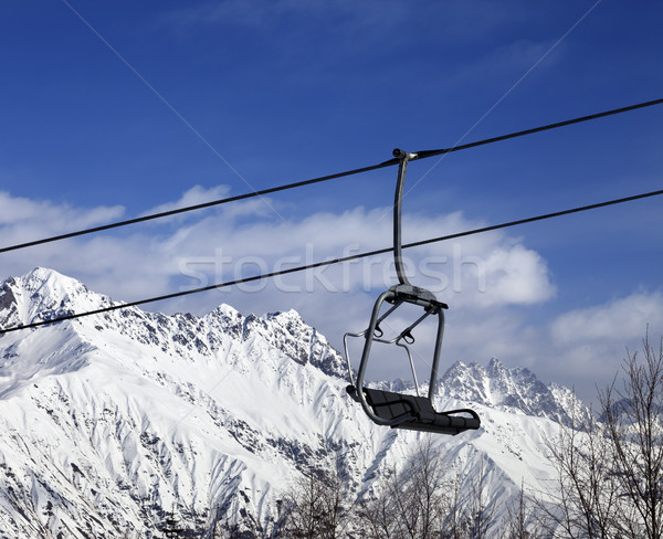 Ski lift in snow winter mountains at nice sunny day Stock photo © BSANI