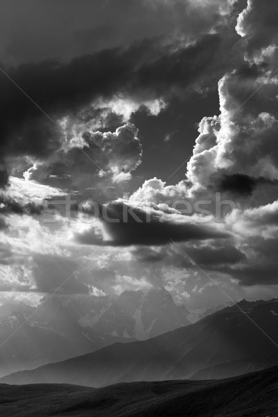 Black and white view on mountains in sunlight clouds Stock photo © BSANI