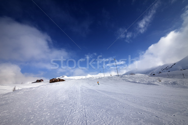 Snowboarder on piste slope in nice day Stock photo © BSANI