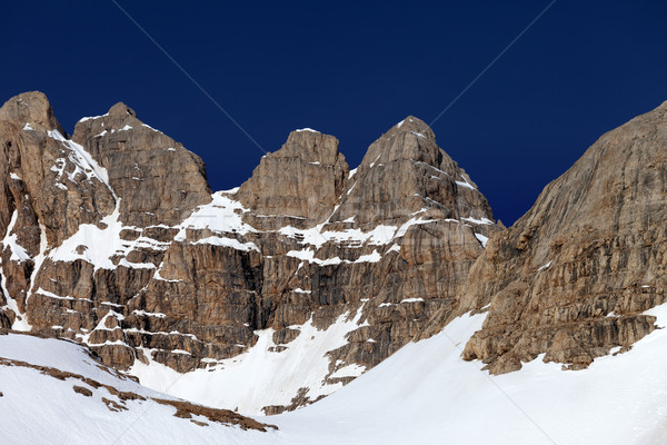 Rocks in snow and blue cloudless sky Stock photo © BSANI