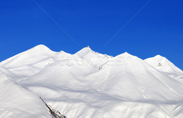 Stock photo: Snowy mountains and blue sky at nice day