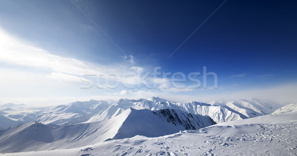 Panoramic view on snowy mountains at nice day Stock photo © BSANI
