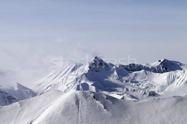 Snowy mountains in fog Stock photo © BSANI