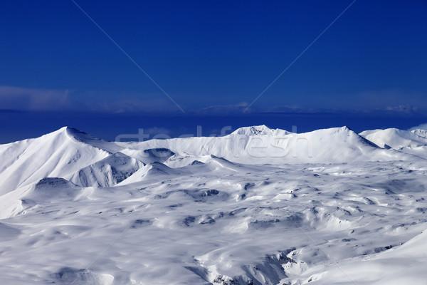 Snowy plateau and blue sky Stock photo © BSANI