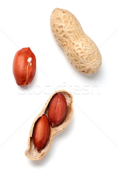 Peanuts on white background Stock photo © BSANI