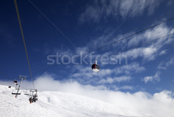 Gondola and chair-lifts at ski resort in nice day Stock photo © BSANI