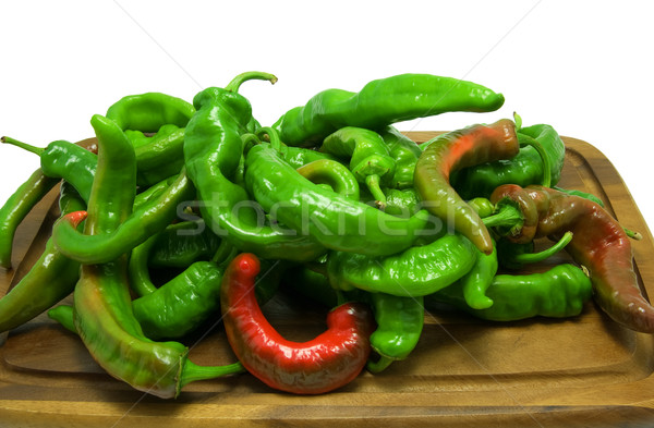 Hot peppers on wooden kitchen board Stock photo © BSANI