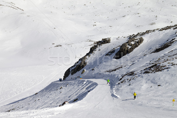 Snowboarders and skiers on groomed slope Stock photo © BSANI
