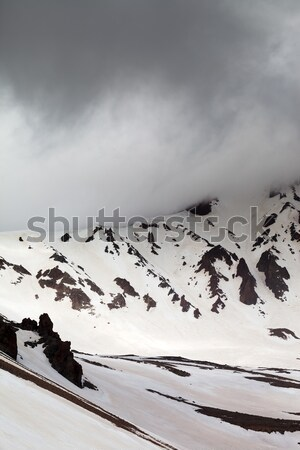 Snowy mountains in bad weather Stock photo © BSANI