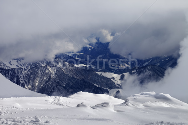 Winter snowy mountains in clouds Stock photo © BSANI
