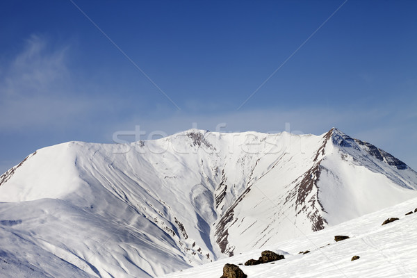 Off-piste slope with stones and snowy mountains Stock photo © BSANI