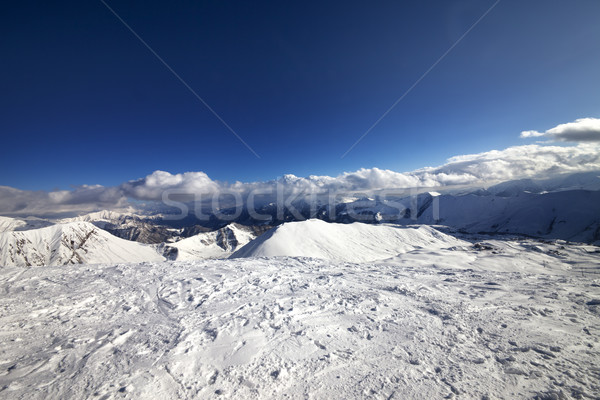 Wide-angle view on off-piste slope and snowy mountains Stock photo © BSANI