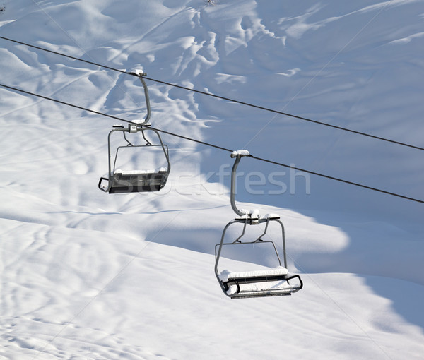 Two chair-lift with snowdrift and off-piste slope in sun morning Stock photo © BSANI