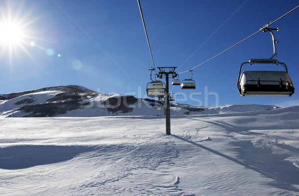 Chair-lift and blue sky with sun Stock photo © BSANI