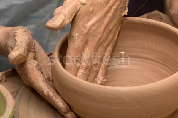 Process of making clay bowl on pottery wheel Stock photo © BSANI
