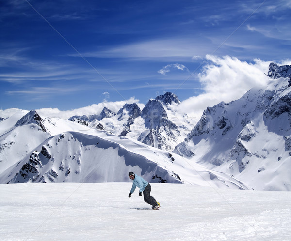 Young snowboarder on ski slope Stock photo © BSANI
