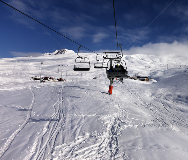 Stock photo: Chair-lift and off-piste slope in nice sun day
