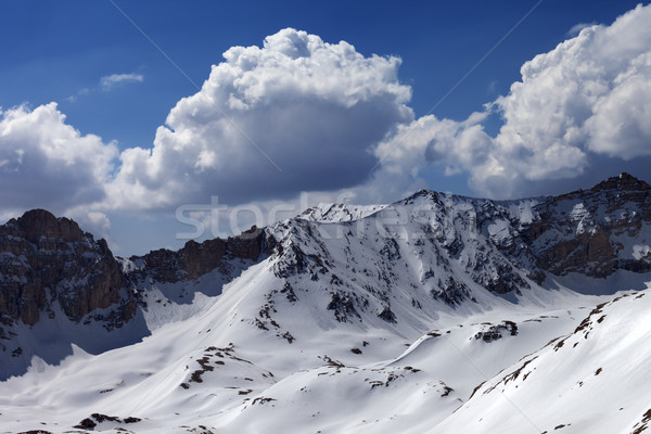 Snowy mountains and blue sky with cloud in sun day Stock photo © BSANI