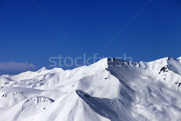View on off-piste snowy slope at sunny day Stock photo © BSANI
