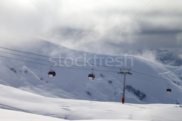 Gondola lifts and off-piste slope in mist Stock photo © BSANI
